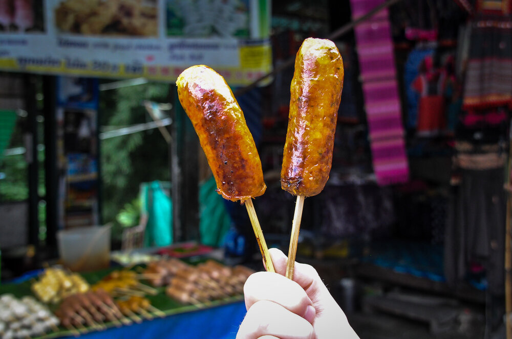 I'm not even that big of a fan of sausage, but I love the vibrant flavors in  sai oua , a sausage made with fresh herbs like lemongrass, kaffir leaves, and chilies. You can only find in northern Thailand, so be sure to give it a try!