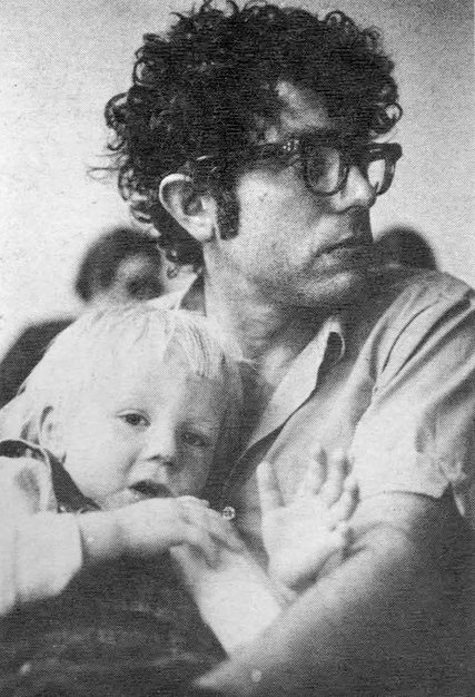 Bernie Sanders held his son during a meeting in 1971 with colleagues from The Vermont Freeman in Burlington, Vt. Photo Credit: Frank Kochman