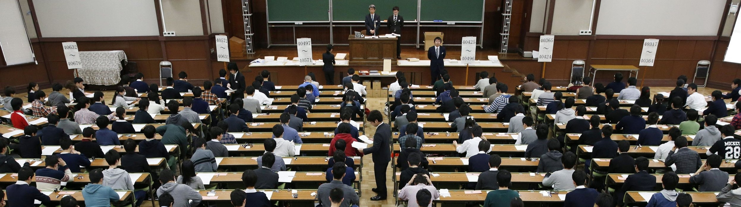 Students wait for their entrance examination to start at the University of Tokyo's Hongo campus. / KYODO