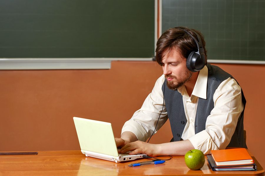 The teaching work is demanding and sometimes overwhelming. A podcast is a free resource that instructors can benefit from while doing something else. - Image: Bigstock