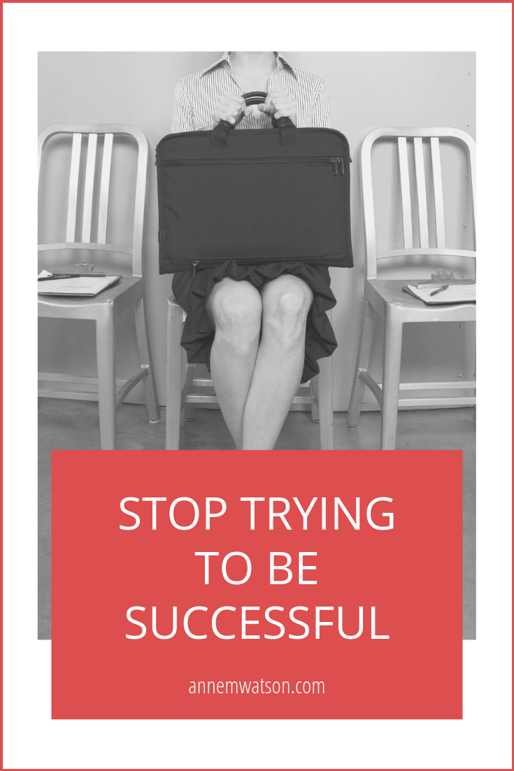 Stop trying to be successful image of woman holding a briefcase.