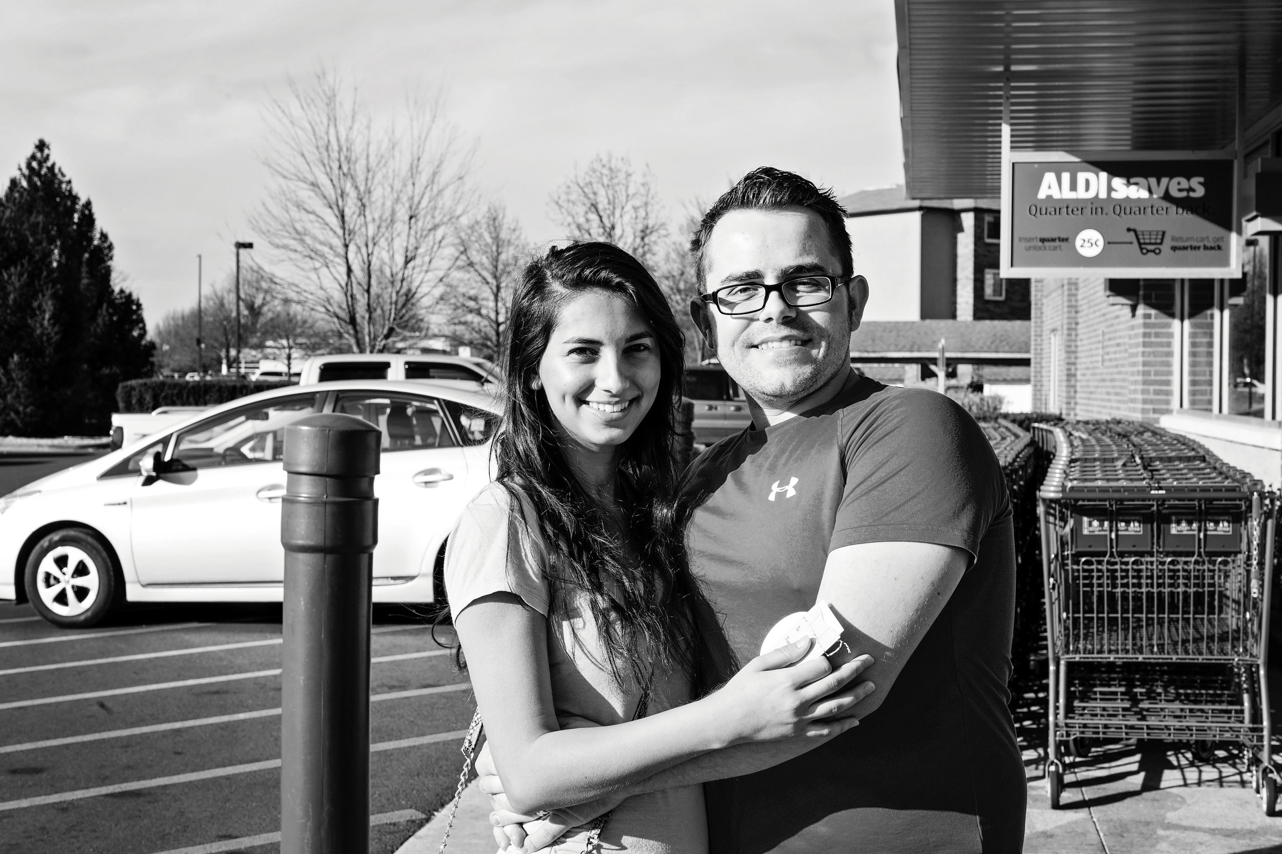 """Lidia and Sam P. - Sam's love for Lidia is evident. When asked what makes him happy, Sam responded, """"being married to my wife"""" while holding her hand. These two are involved in their church and just filled their cart with a lot of yummy food!"""
