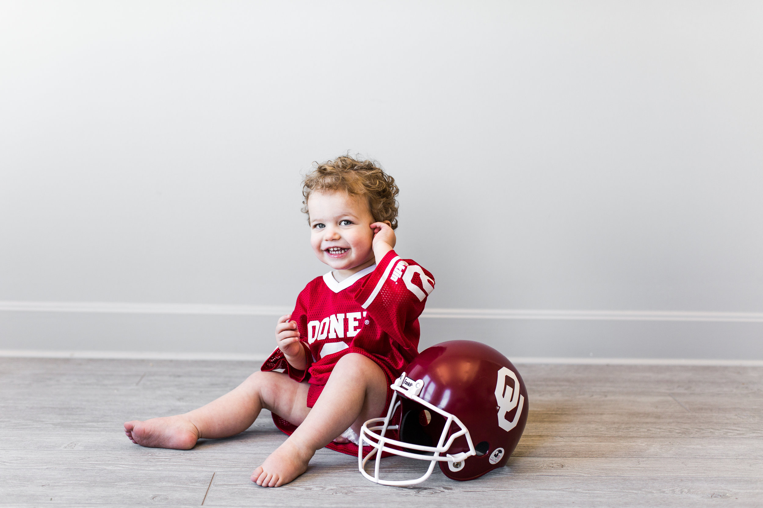 "Funniest thing Sam says that makes you laugh!    ""Sam is always saying things that make us laugh! He talks about OU football in his sleep and it's the first thing he asks to play in the morning...""Play ball, dada?"" He has recently started to grab us by the hands and say ""come on!"" if we don't do something fast enough. He is a little sponge right now and will try to repeat anything you say."""