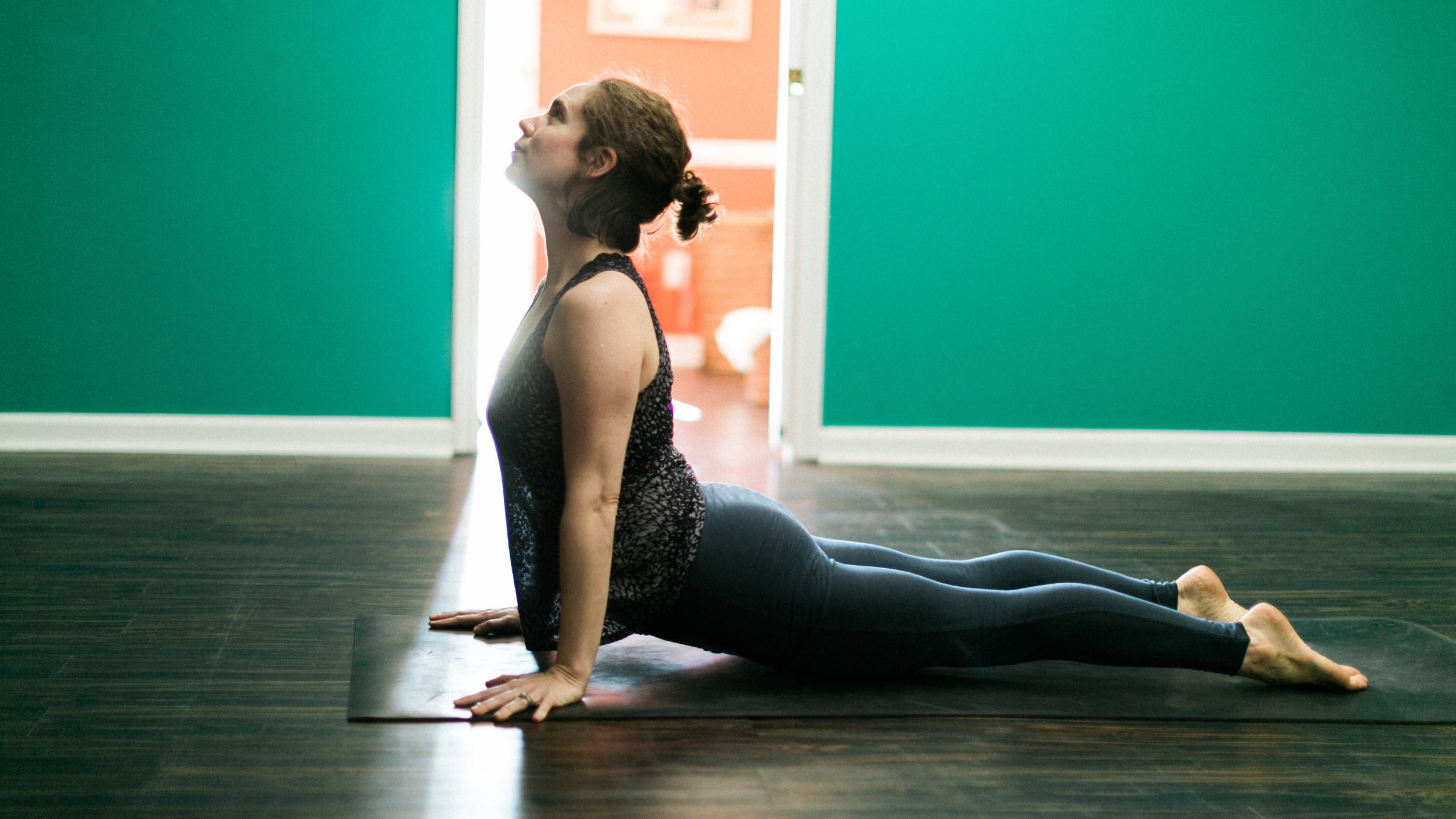 Co-Owner, Ashley Dunwody, in Upward Facing Dog Pose.