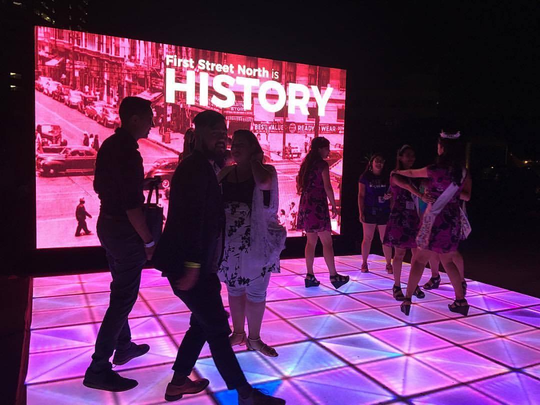 Festival goers on the interactive dance floor on First Street North © Maya Santos