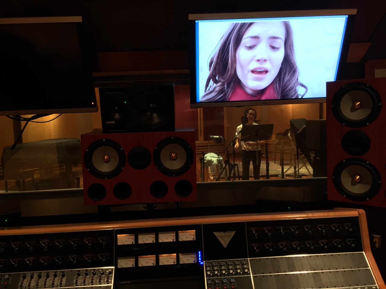 Jacléne Wilk sings along with her moving image in the U-M Duderstadt Center studios.