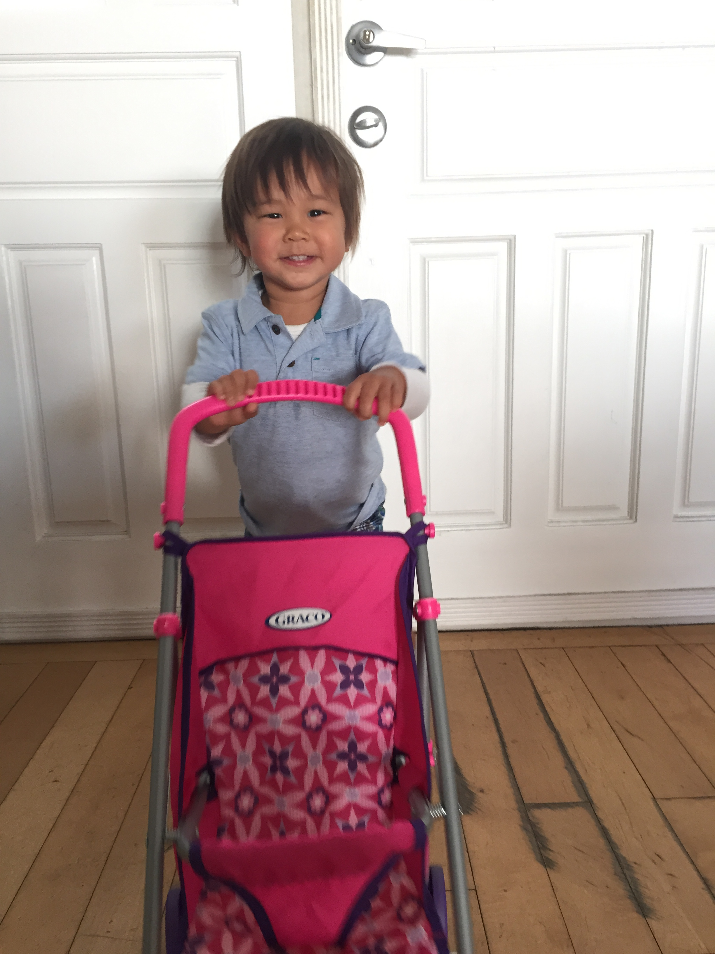 Boys like pink and push strollers around too