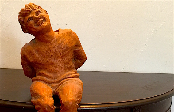 The statue of Daron Hagen sculpted by his mother when he was a boy.