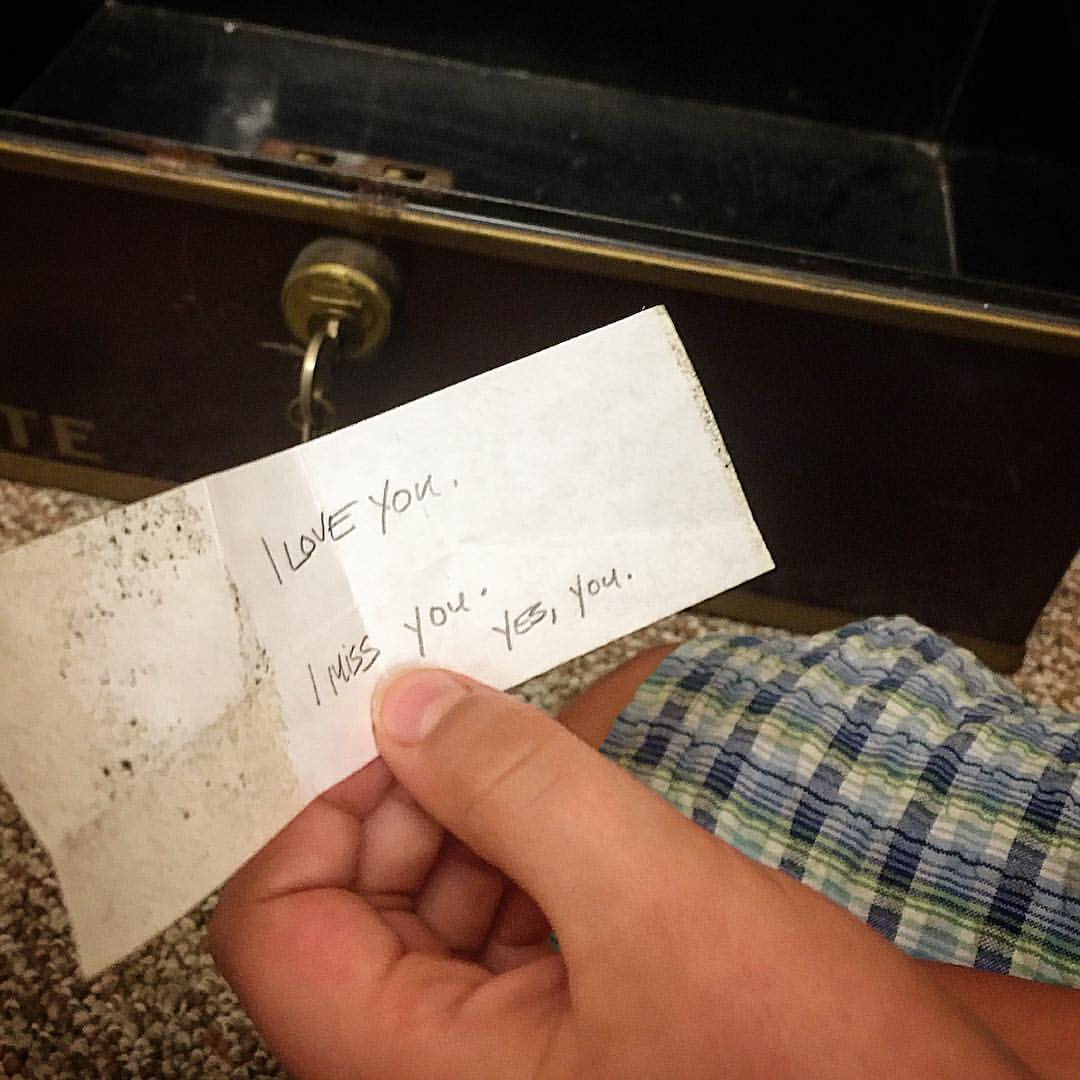 My younger son draws from the lead-lined treasure chest in the library the note that has resided there for a long time and left, as far as he was concerned, just for him. And, at Yaddo, why not? (Photo credit: Hagen Collection)