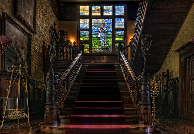 The Grand staircase. Katrina Trask is portrayed in the Tiffany window. (Photo credit: Hagen Collection)