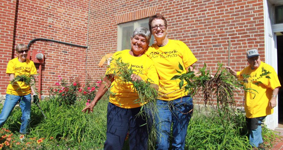 Members of New Jerusalem Lutheran Church working in the garden. Lovettsville, Virginia.