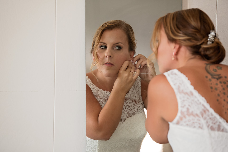 Mallory putting the final touches on her bridal look before the ceremony