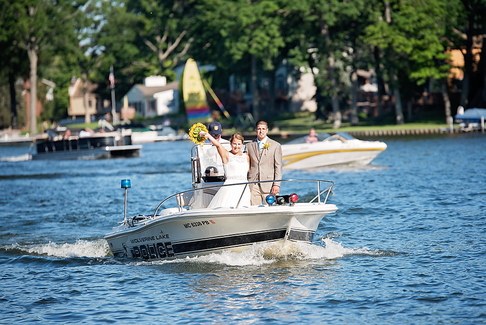 It's not every day you get a escort to your reception on the water by the Wolverine Lake Police Department!