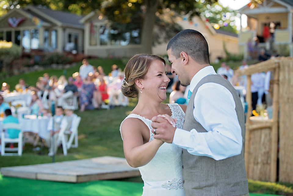 The newlyweds grinning ear-to-ear during their first dance