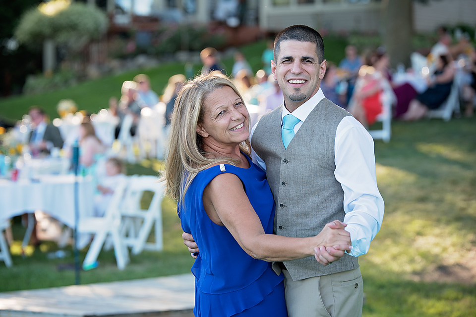 Charlie & his mother, happy as can be, during their dance