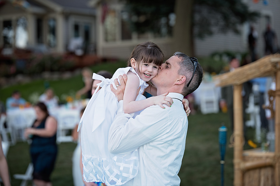 The flower girl dancing with her father
