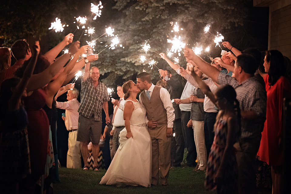 Exiting their wedding reception in style, surrounded by the ones they love & sparklers!