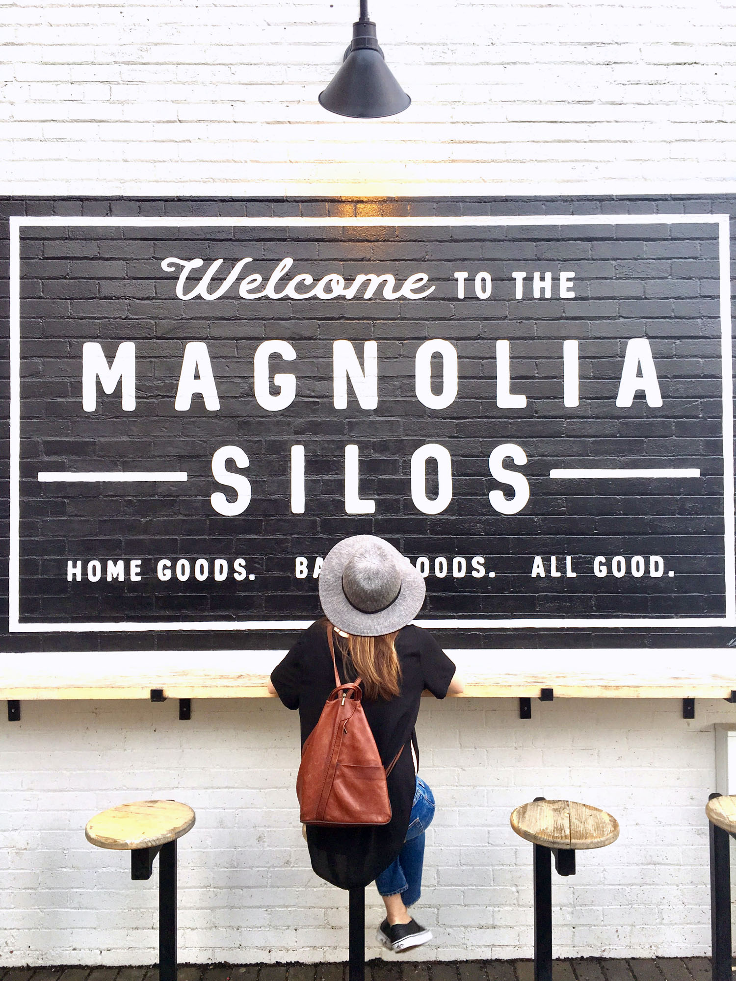 Some of my favorite simple details at Magnolia are the lovely and perfectly minimal signs on the flawless white brick walls.
