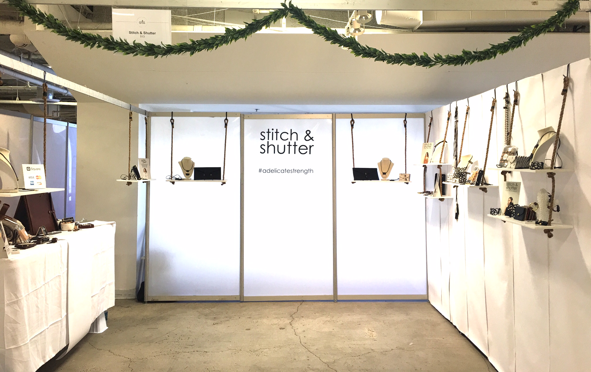 The Stitch & Shutter Leather Goods booth at Artisanal LA- April 1 & 2, 2017 in DTLA. This was an all new set up, perfect for a fresh spring take with greenery and swing-inspired rope shelves.