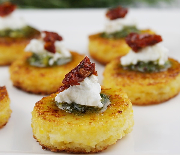 appetizing bites - Move over cheese and crackers, there's a new starter in town. I am admittedly obsessed with these  Sundried Tomato Polenta Bites  from Recipe Girl. When sundried tomatoes and goat cheese are two of your favorite things, what's not to love? I make this recipe even quicker by using Ancient Harvest GF Polenta & even a store bought dairy-free pesto when I'm really crunched for time.