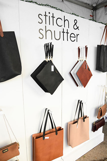 Stitch & Shutter booth detail at Spring at the Silos 2019- handmade leather bag wall