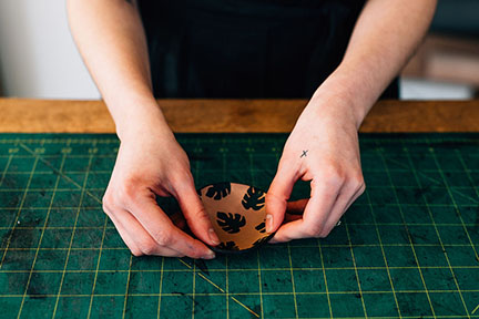 Megan finishing a mini leather print bowl in the Stitch & Shutter Studio