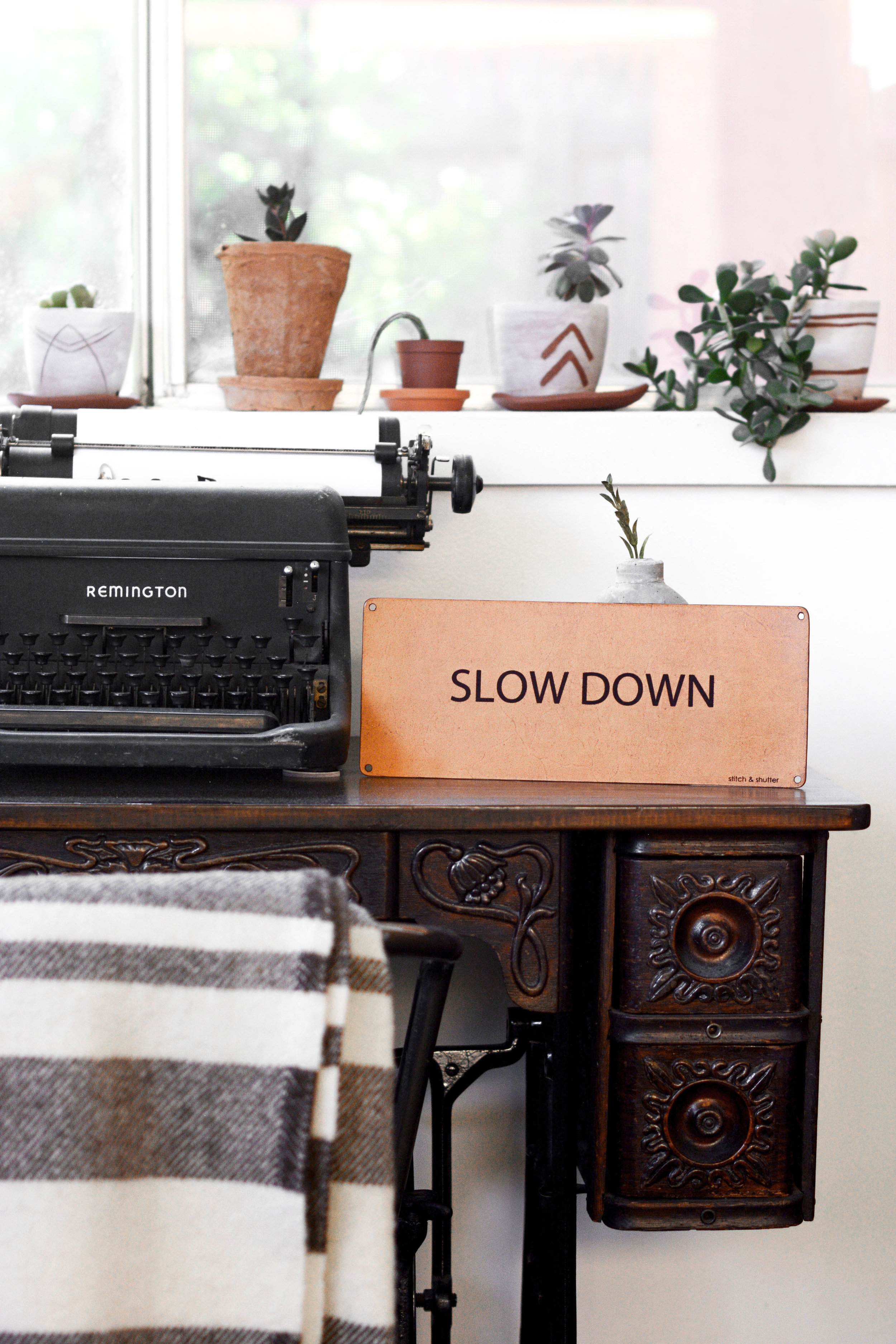 slow-down-sign-desk.jpg