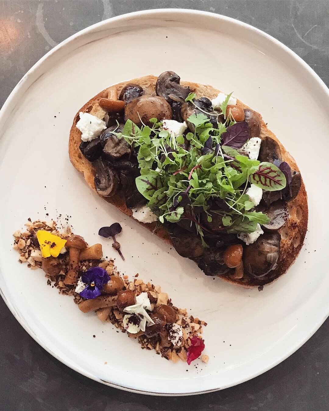 17-23 January - Locally foraged sumac spiced wild mushroom bruschetta, on our stone baked artisan sourdough, goats cheese and toasted almonds.