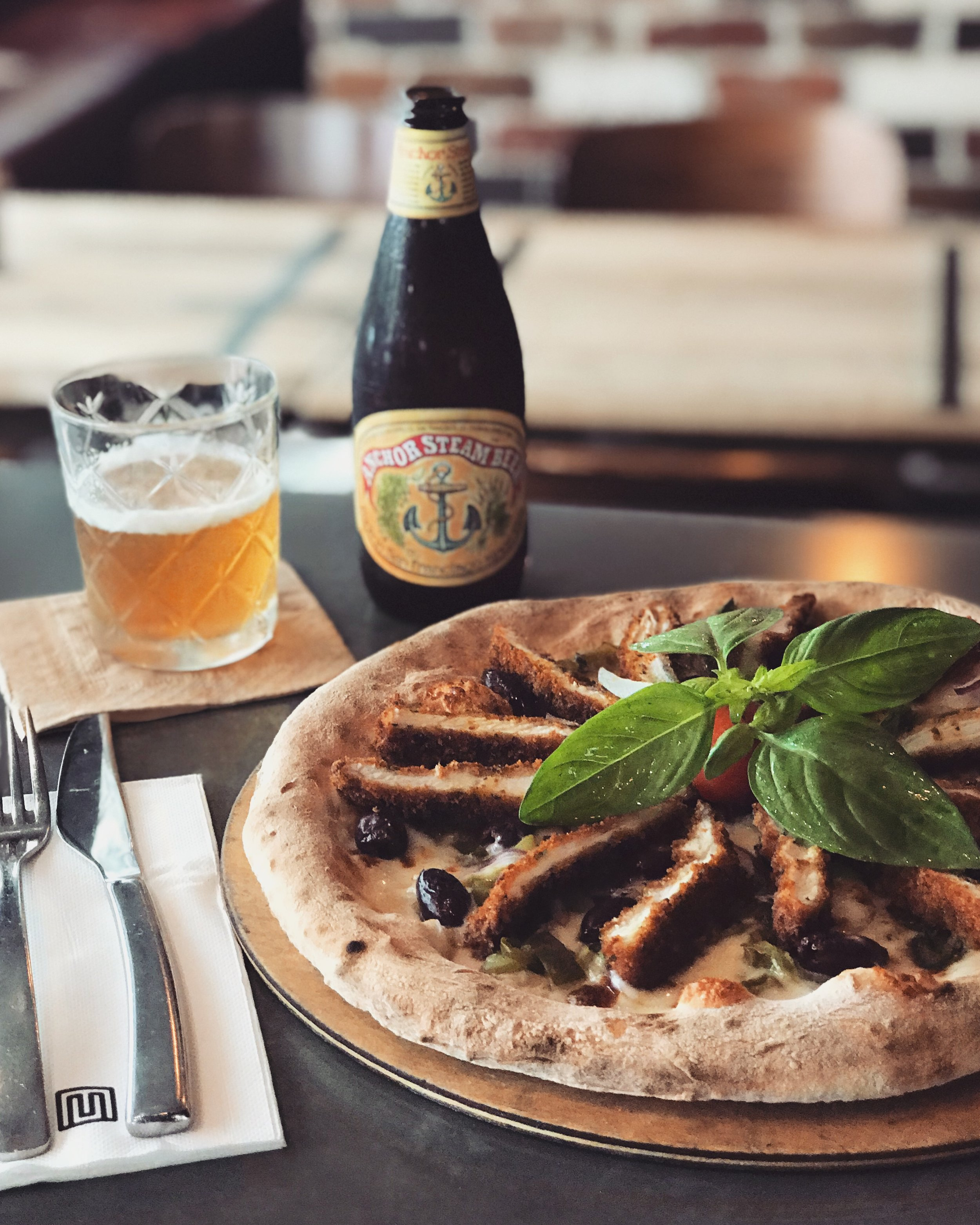 6-12 December - Moroccan spices and parmesan crumbed chicken breast, fresh jalapeno chillies, onion, capsicum, olives, chilli mayo and fior di latte mozzarella.Our drink recommendation is Anchor Steam from San Francisco.