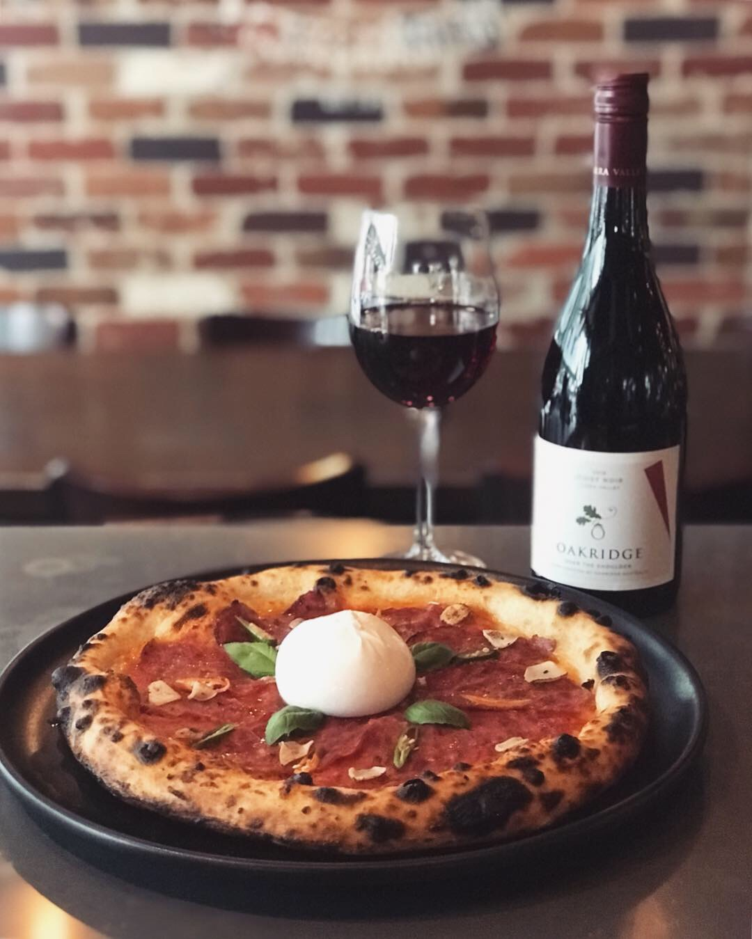 20-26 March - Nothing beats this heart-warming, comforting spicy pizza on a wet Autumn day.Burrata, salame Calabrese, San Marzano tomato, mozzarella, basil.Matched by a playful glass of Oakridge Pinot Noir (Yarra Valley, VIC).