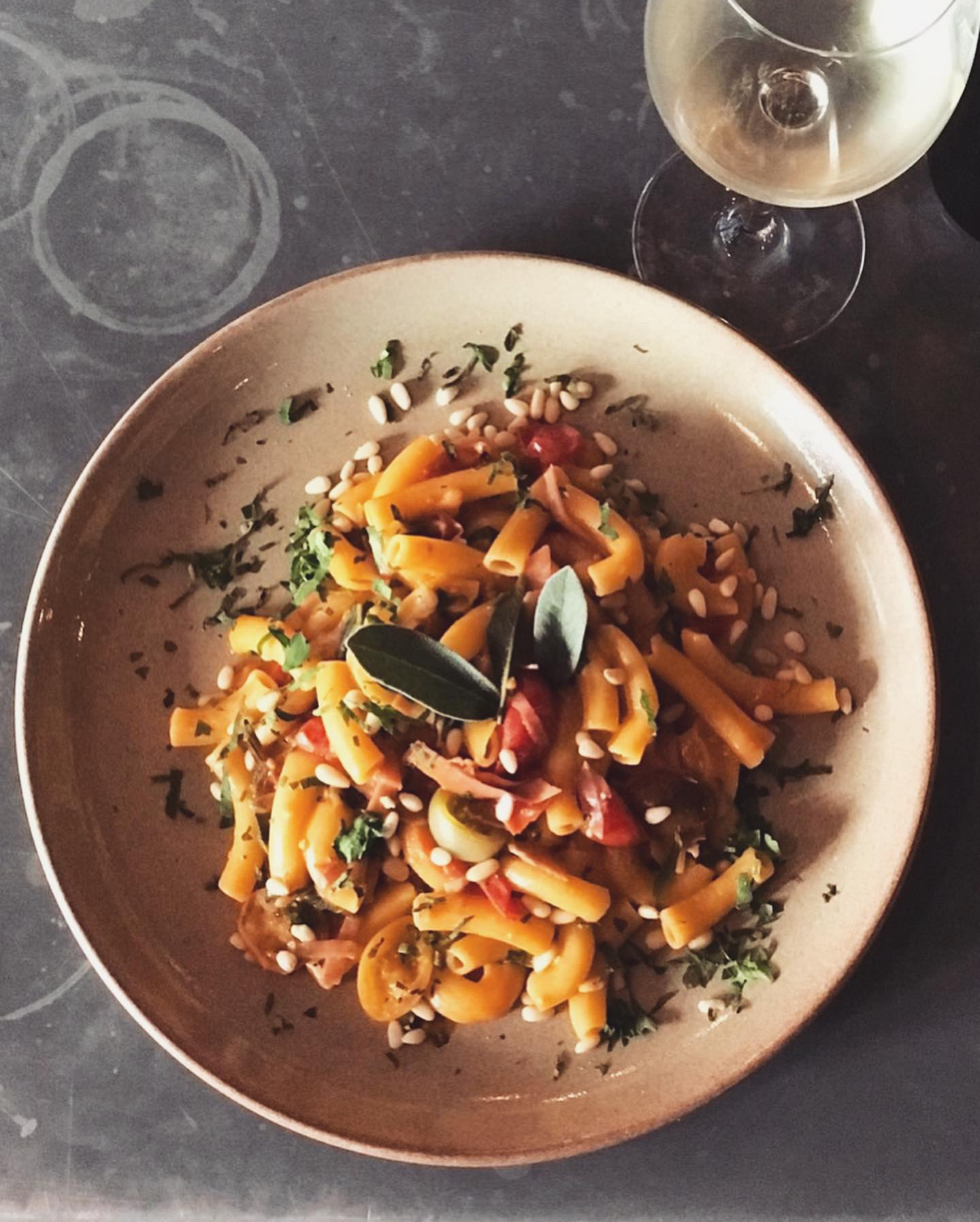 22-28 May - This week's pasta feature sees our saffron-infused homemade macaroni with speck, blistered sage, heirloom tomatoes and pine nuts.