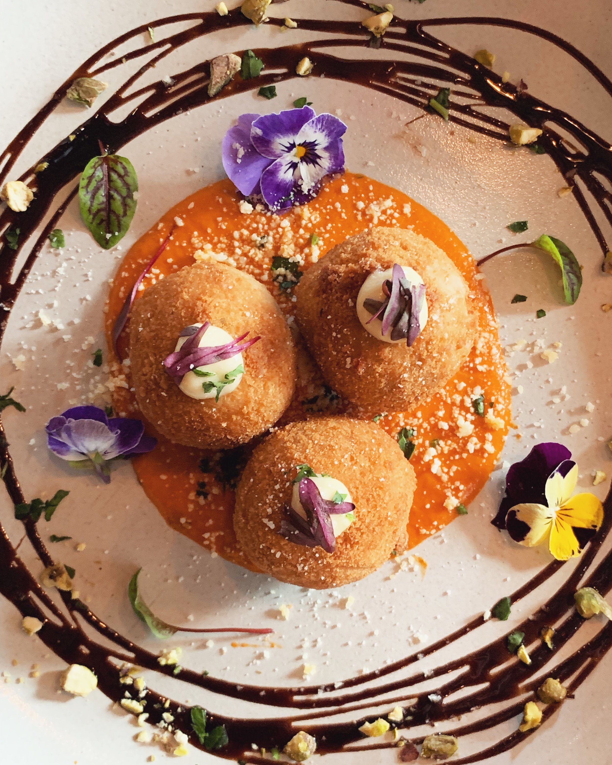25 June - 2 July - These aren't just any arancini! Our entree special this week brings you white Spanish bean croquettes with Smokey scamorza cheese, on a cradle of Nonna's napoletana sauce.~All luncheons deserve a good party starter!