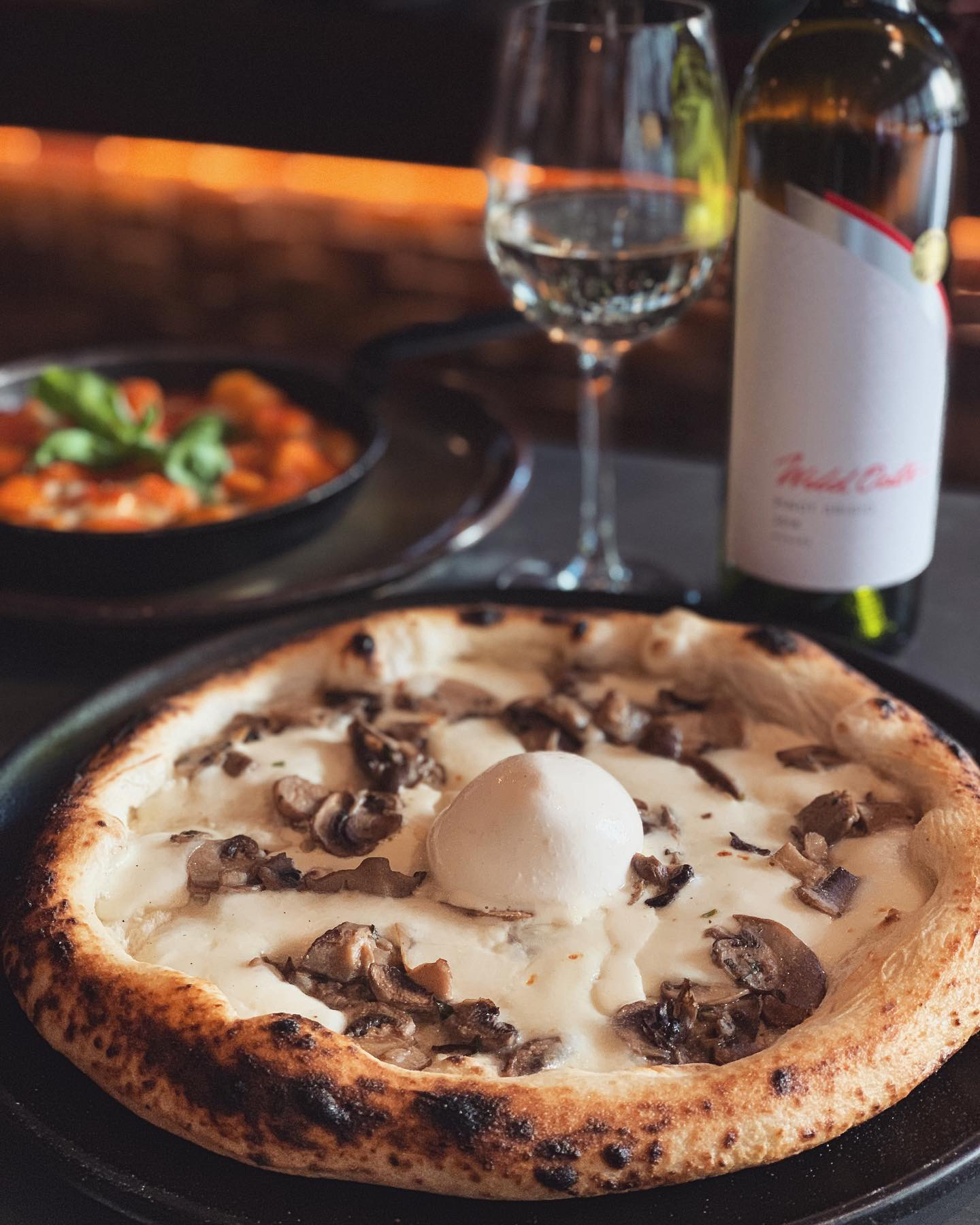 10-16 July - ~ PIZZA FUNGHI BIANCHI ~.This week's special features a white mushroom pizza with a soft heart of truffle-infused creamy burrata. The delicate flavour of burrata cheese embraces the truffle and gives it a whole new dimension. Perfect for all our cheese lovers out there!