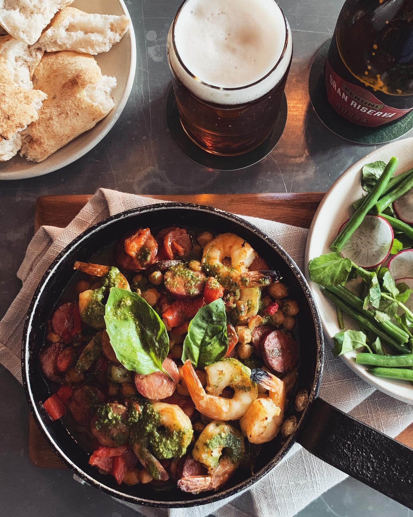 28 August - 3 September - ~ S T U F A T O ~This week we have the perfect dish for those of you who crave a wholesome, comforting end-of-winter feed.// Slow cooked stew of QLD tiger prawns, smoked Spanish chorizo, piquillo peppers, chickpeas, herbs and generous cold pressed extra virgin olive oil, served with a salad of picked radish, green beans and watercress. //.To wash it down, we recommend our Peroni Gran Riserva Rossa, a bold lager with darker colour and a flavour that can keep the potent flavours of our stew I check 🍺 👌🏻 .