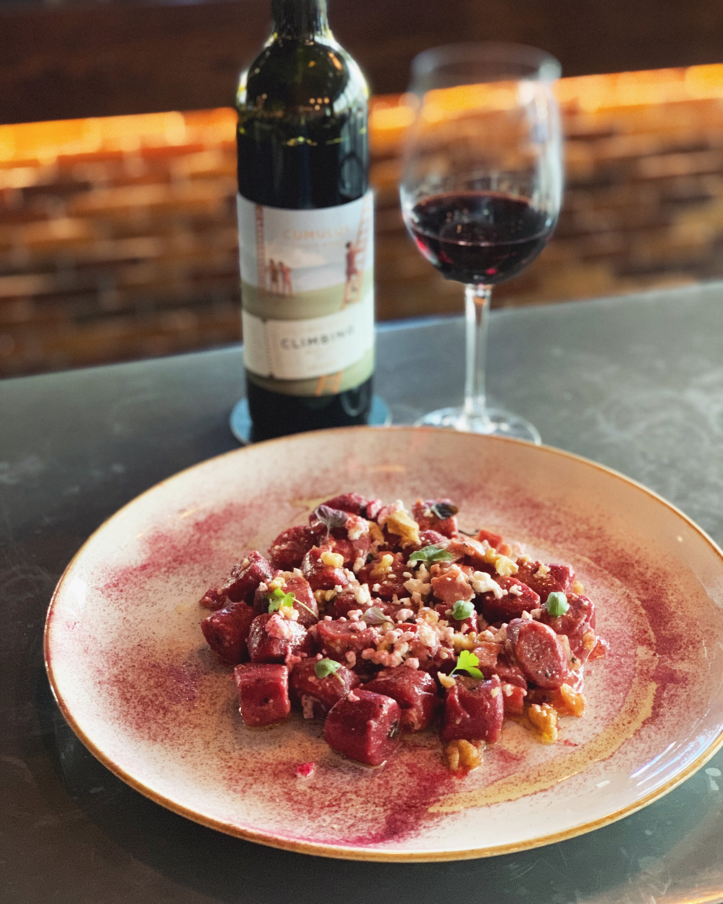 11-17 September - ~ R E D G N O C C H I ~// Beetroot infused, hand cut gnocchi, pancetta, roasted walnuts, goat's cheese and olive oil. //The tang and sweetness of the beetroot marry the saltiness of the goat's cheese and the pancetta - all topped off by roasted walnuts for an extra nutty flavour..Best enjoyed with a glass of merlot, like our 'Climbing' Merlot, from Orange NSW.