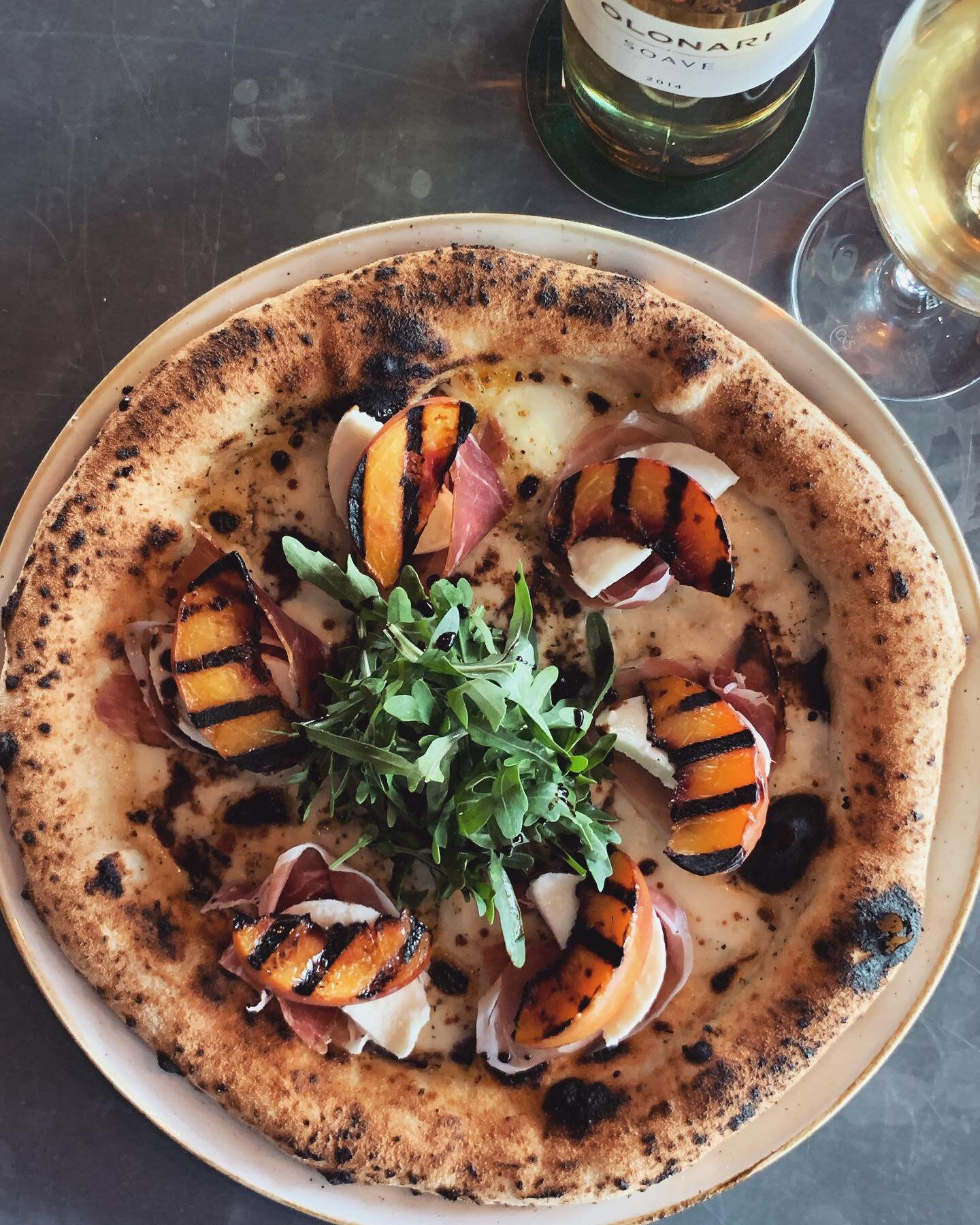 11-17 September - What could possibly be better than the sweetness of a peach and saltiness of prosciutto combined?This week's pizza special features// Ripe peaches, prosciutto di Parma, buffalo mozzarella, roquette and #evoo. //