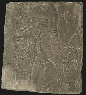 Mesopotamian, Assyrian Relief Showing the Head of a Winged Genius, Neo-Assyrian Period, reign of King Ashurnasirpal II (883 B.C.–859 B.C.)  ( Photograph courtesy of the Art Institute of Chicago)