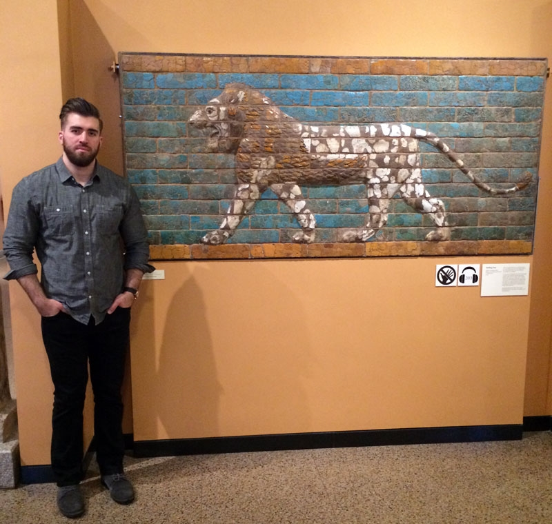 "Paul Khio, 26, stands in front of a Babylonian lion, dating back to Iraq's Neo-Babylonian Period, ca. 604-562 B.C. ""History helps remind us of the valuable contributions to civilization, the awe inspiring grandeur, and the rich story these artifacts illustrate,"" said Khio on a visit to the Oriental Institute in Chicago.  (Photo by Ramsen Shamon)"