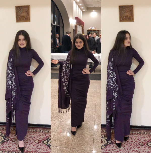 Sekhwa wearing a dress she designed featuring a scarf made by Assyrian Heritage. Photo courtesy of Sekhwa.