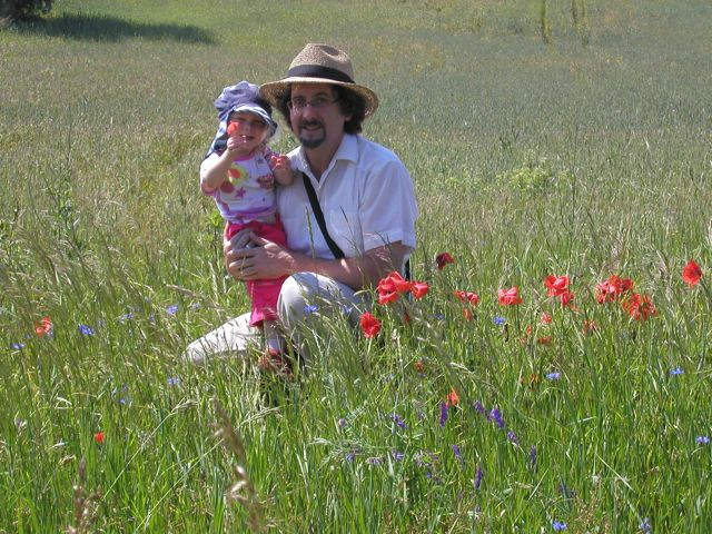 Chuck with Charlotte, our godchild, in a poppy field in Germany. (c) AF