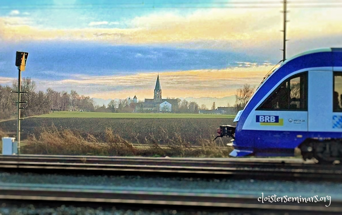 View from the train tracks to St. Ottilien. The blue you can see behind the abbey, even with the top of the trees, is the Alps in the distance.