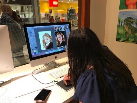 Image of a student doing digital art.