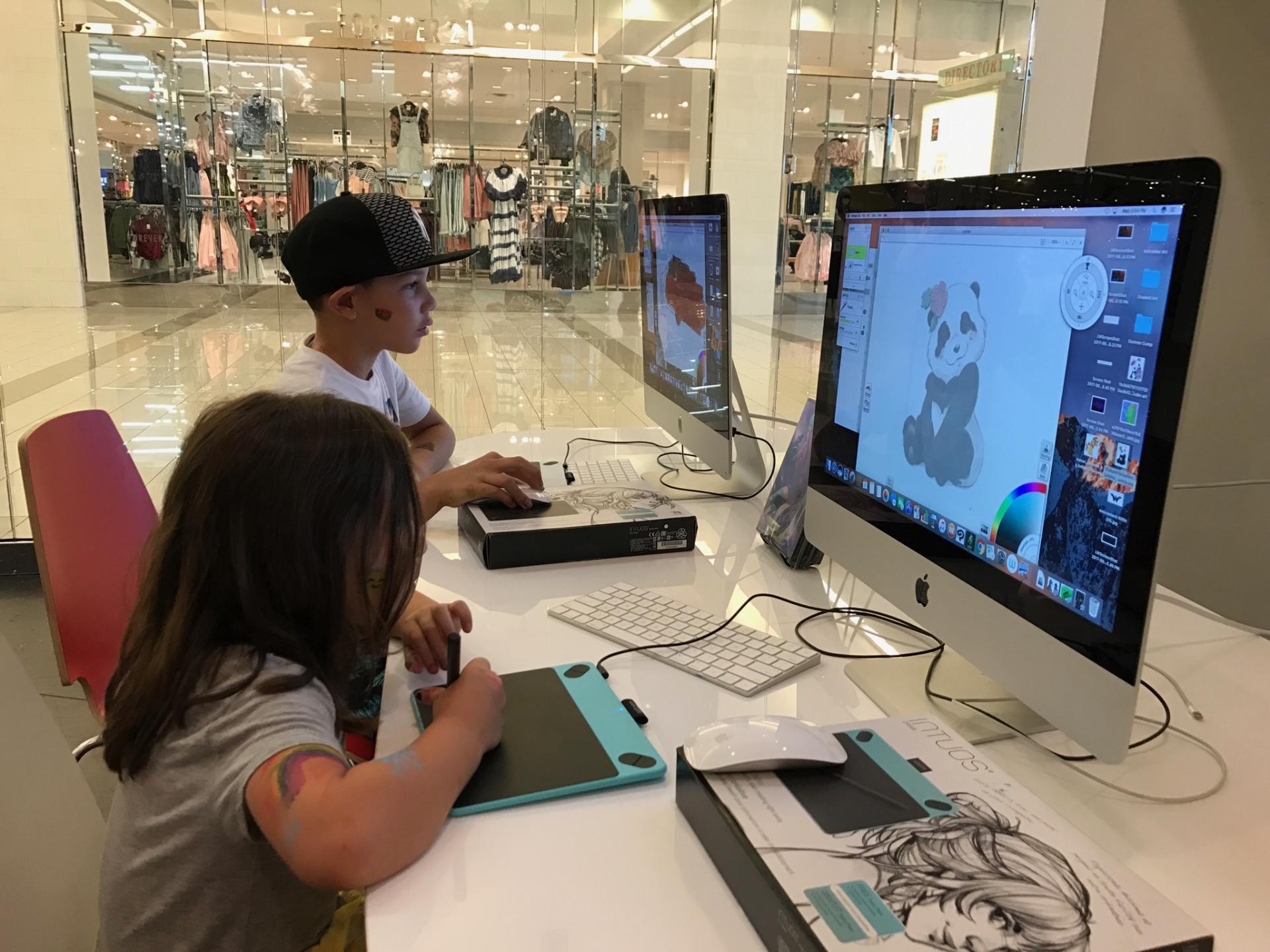Image of students doing digital art.