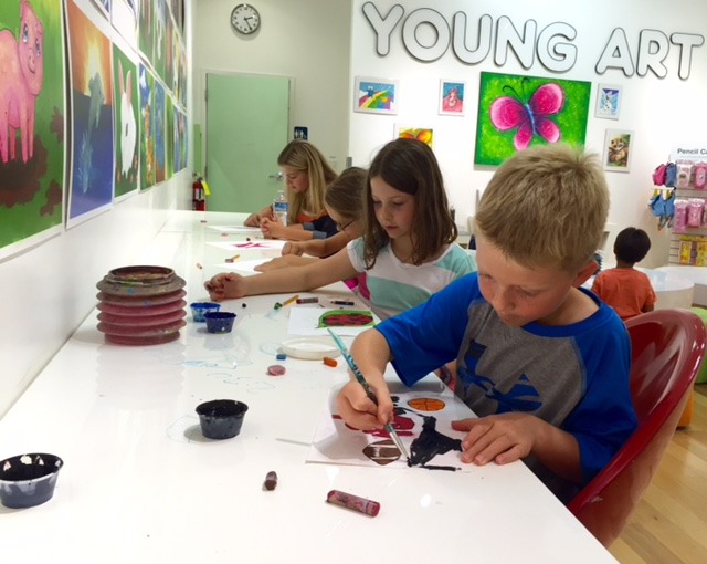 image of students doing art in a camp class