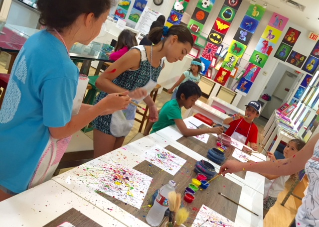 Image of students splatter painting.