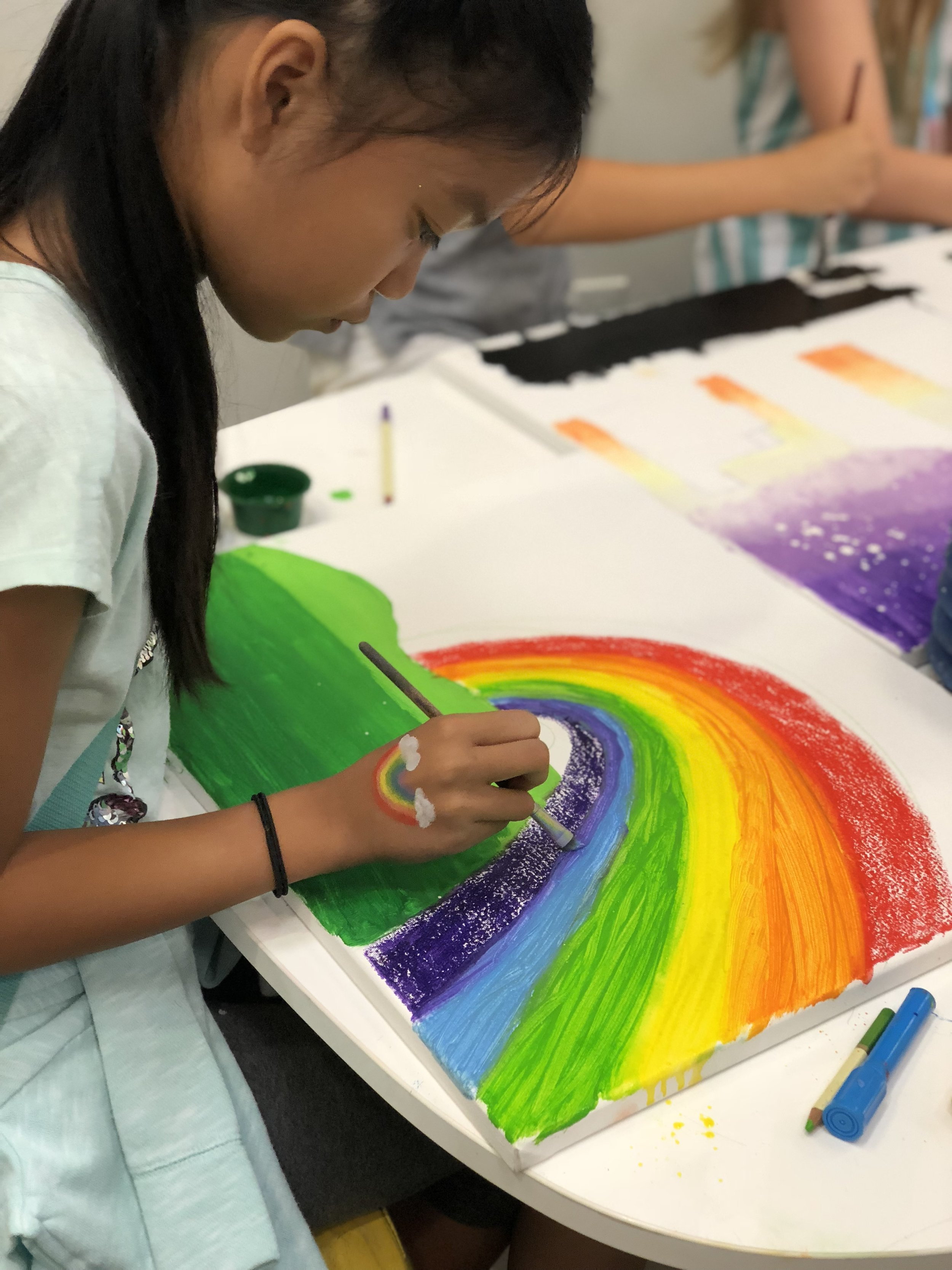 Student making a piece of art.