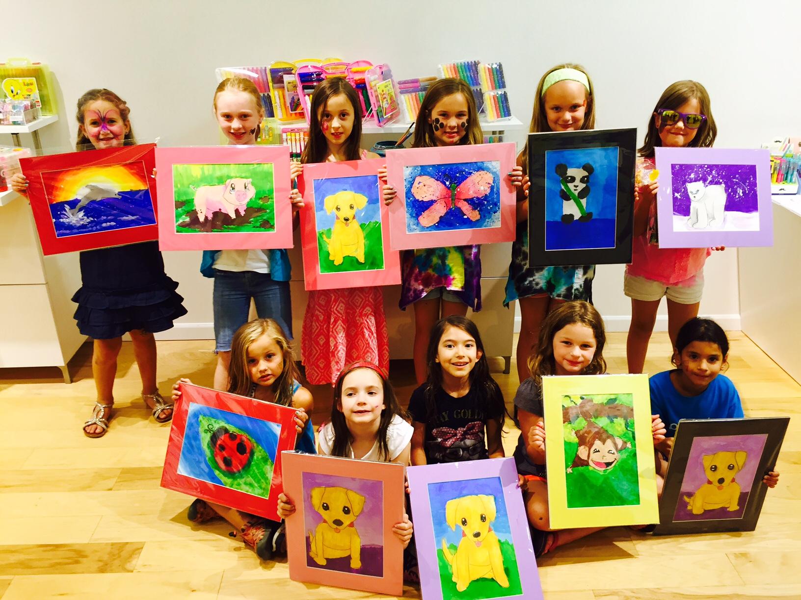 Image of kids holding art.