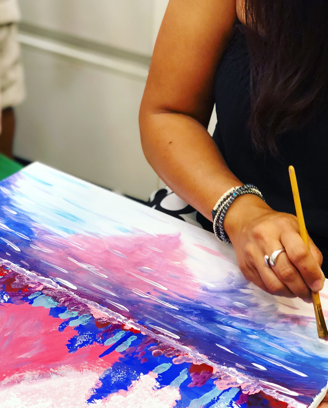 Image of a person painting.