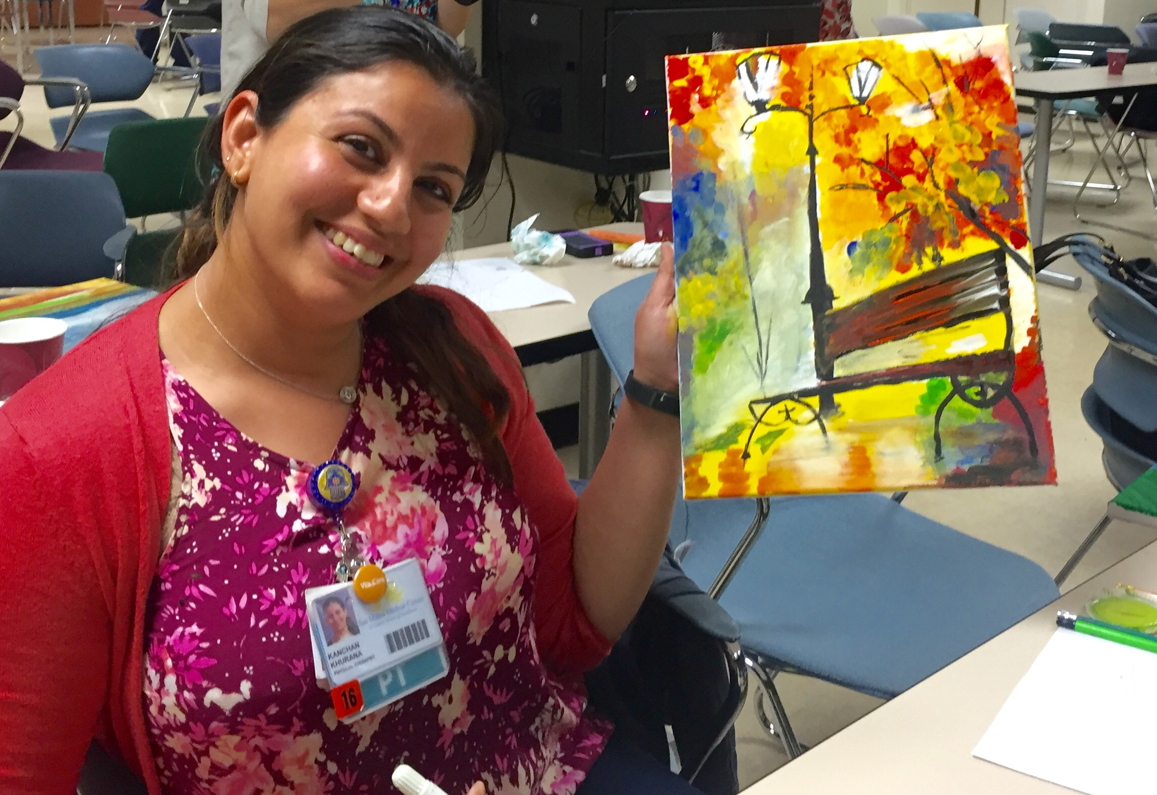 Image of a woman holding a painting.