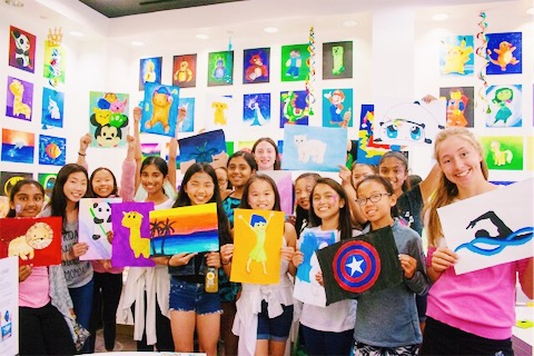 Image of students holding their art.